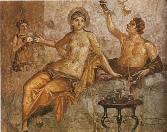 A Roman couple eating. The man is laying down, the woman is sitting