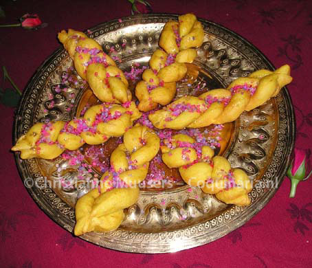 The deep-fried braids are sprinkled with coloured sugar