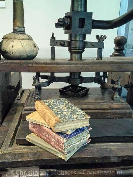 18th-century cookery books on a printing press from the same century in the Library Special Collections in Amsterdam
