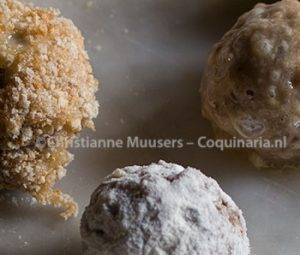 Three stages of breading the bitterbal: flour (center) - egg (right) - breading (left)