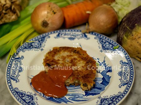 The vegetable cutlet with sauce and the vegetables that were used in the background